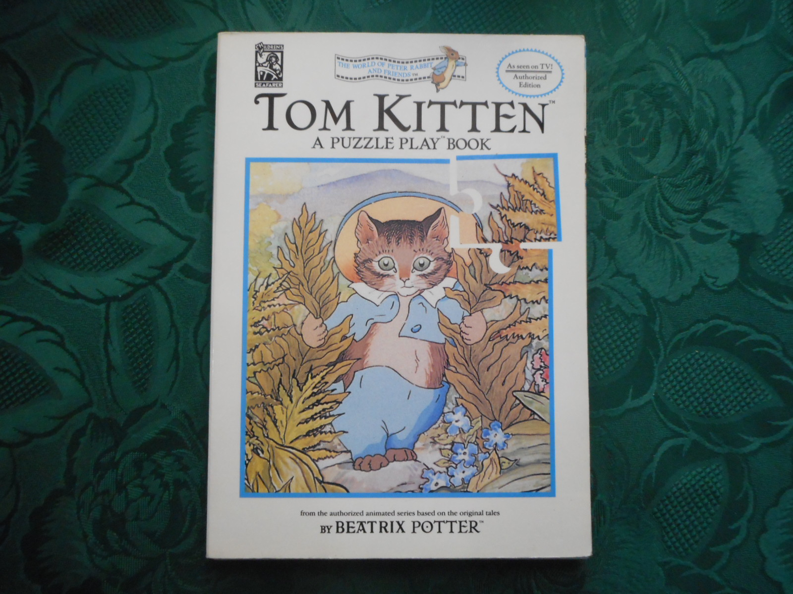 Tom Kitten. A Puzzle Play Book